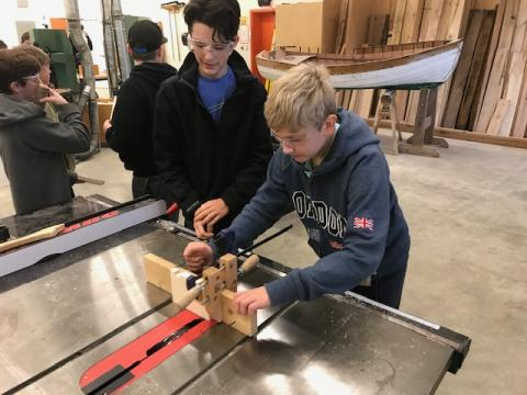 Students with bandsaw
